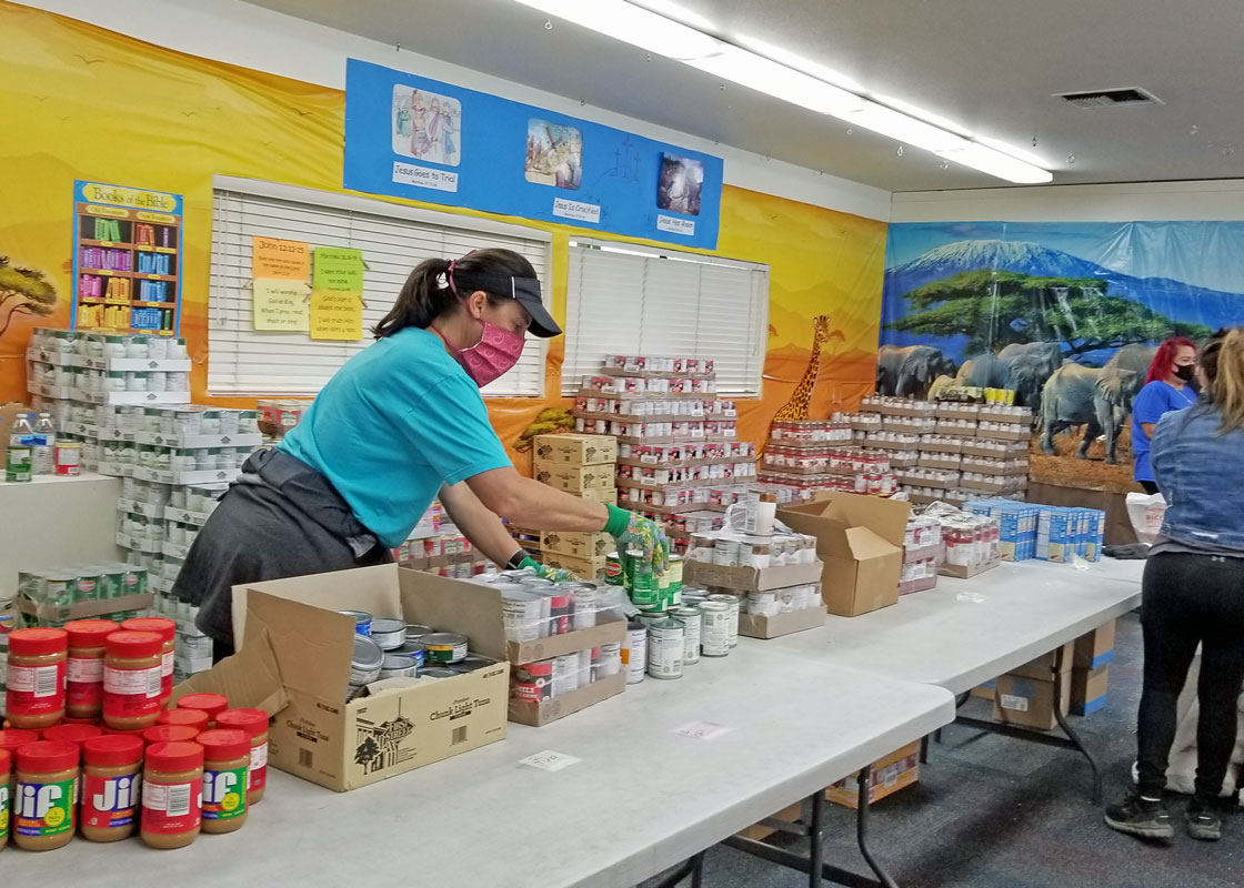 Volunteers pack Food Parcels